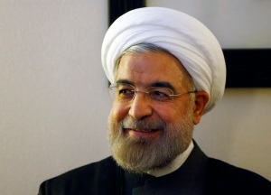 File photo shows Iranian President Rouhani listening to WEF founder Schwab during a meeting at the annual meeting of the World Economic Forum (WEF) 2014 in Davos
