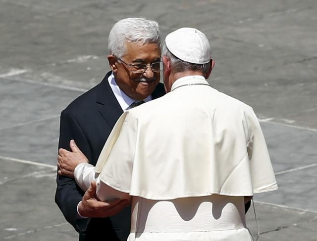 Pope Francis embraces Palestinian President Mahmoud Abbas at the end of the ceremony for the canonisation of four nuns at Saint Peter's square in the Vatican City